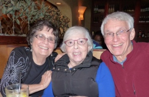 Classmate Maria Messina (center), and her husband (right) and Classmate Marsha Clinard (left)
